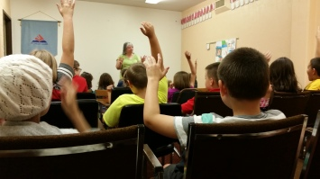 Image of Miss Tammi leading children during Pioneer Club.